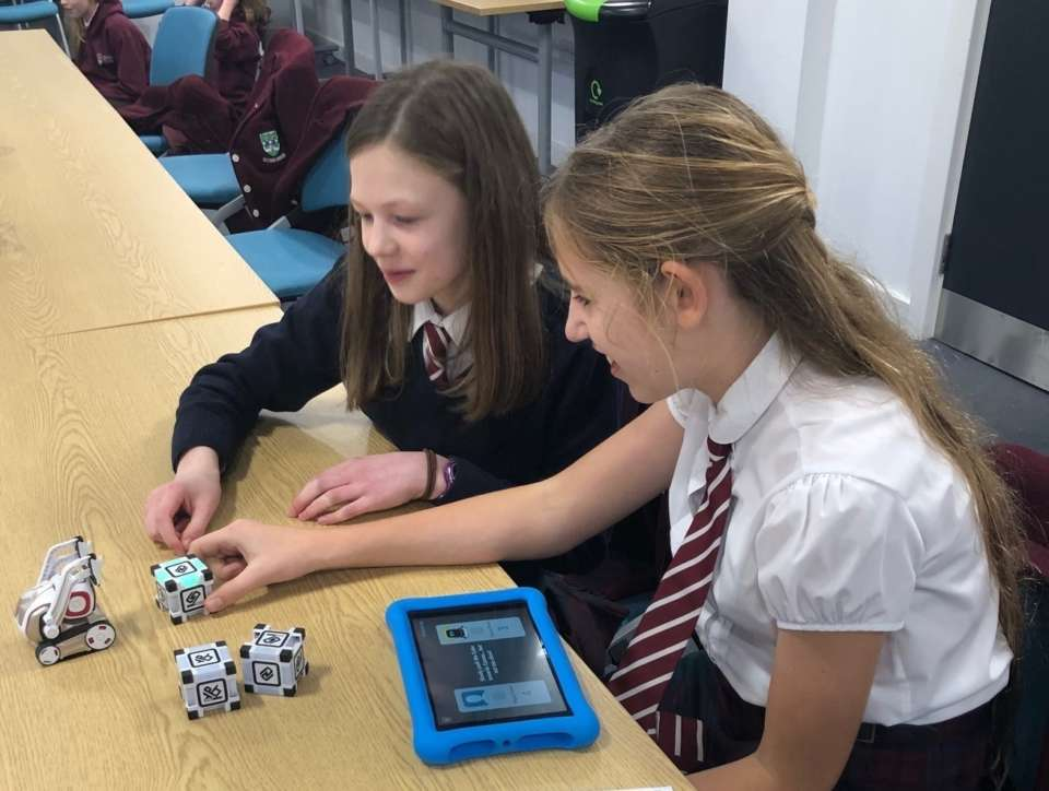 Pupils learning to code the Cozmo robot