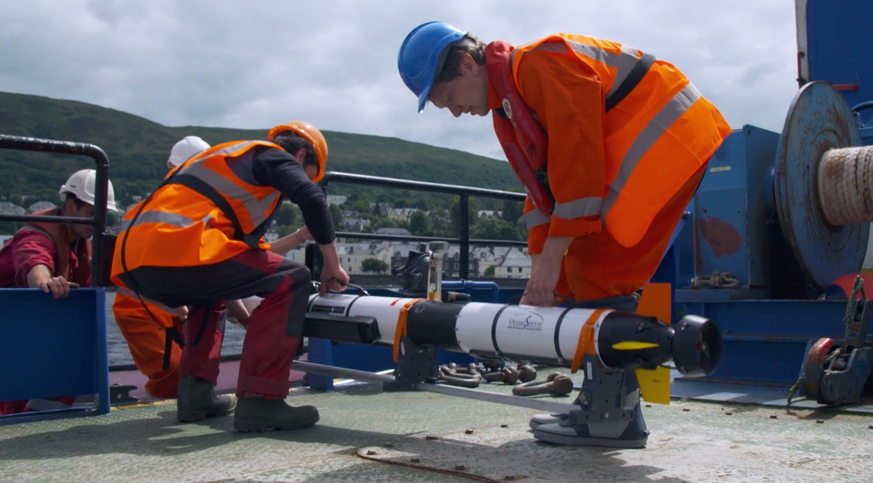 Lowering the Sonobot into the water at Fort William